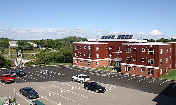 MARKET SQUARE COMMONS ? Solar panels on the roof of the new 28-unit apartment building in downtown Houlton are among the many energy-saving features that also include wood pellet boilers. (Houlton Pioneer Times Photo/Elna Seabrooks)