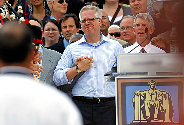 Glenn Beck, center, holds hands with faith leaders at the &quotRestoring Honor&quot rally in front of the Lincoln Memorial in Washington Saturday, Aug. 28, 2010.(AP Photo/Alex Brandon)