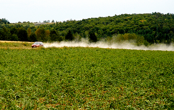 A car kicks up dust on a road in Fort Kent, Maine, on Saturday. Dry conditions mean dusty roads around Maine this summer. The lack of rain is impacting the size, if not the quality of the 2010 potato crop.  PHOTO SPECIAL TO THE BANGOR DAILY NEWS BY JULIA BAYLY