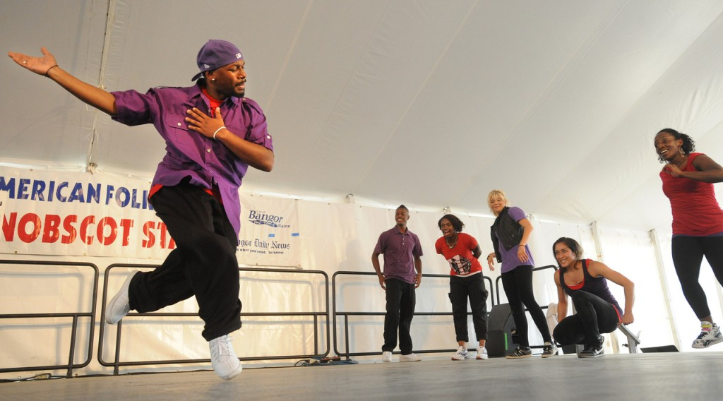 Junious Brickhouse (left) dances his solo during the Dance House portion of the Urban Artistry group during the American Folk Festival at the Penobscot Stage Stage Saturday. (Bangor Daily News/Gabor Degre)