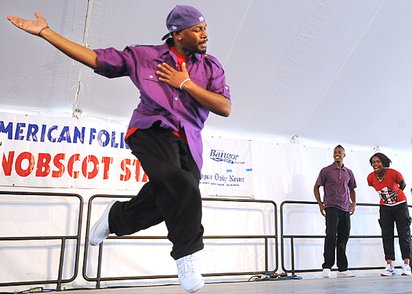 Junious Brickhouse (left) dances his solo during the Dance House portion of the Urban Artistry group during the American Folk Festival at the Penobscot Stage Stage Saturday. Buy Photo
