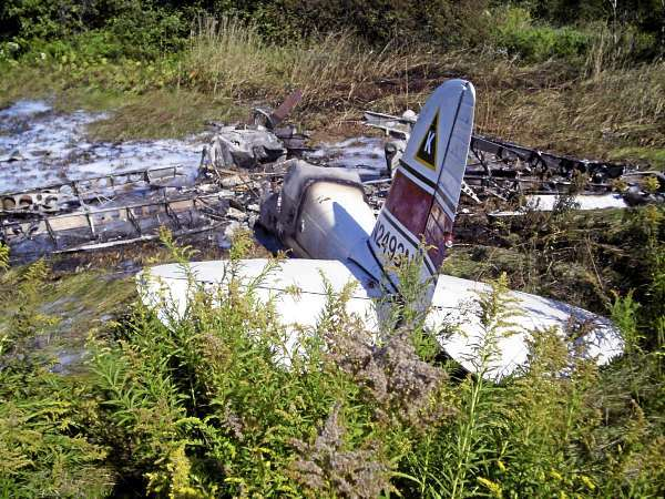 The remains of a 1949 Cessna 120 rest in a grassy field near Knox County Regional Airport on Sunday afternoon. The pilot; William Hamilton of Damariscotta; reported that the plane lost power while he was attempting to take off. Hamilton suffered a broken arm and other minor injuries in the crash; according to police. (Photo courtesy of Maine State Police Trooper Patrick Hood)