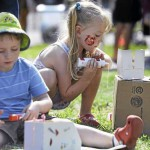 Children at festival construct dream city from boxes