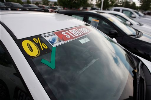 FILE - In this file photo taken June 27, 2010, the zero percent interest rate available is posted on the windshield of an unsold car at a dealership in Lakewood, Colo. Car owners often pay far more than necessary for financing. The good news is that auto loans, like mortgages, can be refinanced. (AP Photo/David Zalubowski, File)