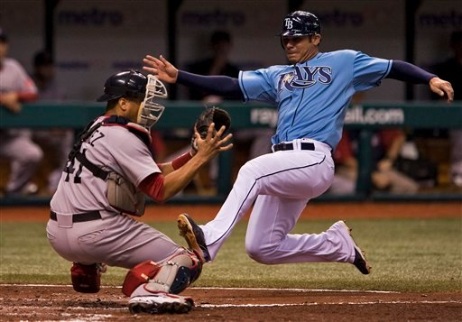 Boston Red Sox catcher Victor Martinez (41) blocks the plate as he tags out Tampa Bay Rays' Carlos Pena during the sixth inning of a baseball game Sunday, Aug. 29, 2010 in St. Petersburg, Fla. Pen was trying to score from second on Dan Johnson's single. (AP Photo/Steve Nesius)