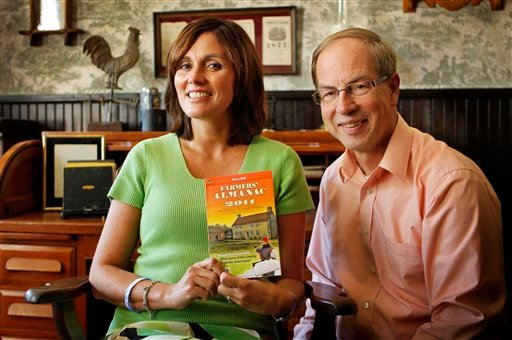 Farmers' Almanac managing editor Sandi Duncan, left, and editor Peter Geiger pose with a copy of the 2011 almanac Thursday, Aug. 26, 2010, in Lewiston, Maine. The Farmers' Almanac says most of the nation can expect a &quotkinder and gentler&quot winter season but New Englanders who enjoyed a respite from brutal cold last winter will find colder-than-normal weather to be a &quotslap in the face.&quot (AP Photo/Robert F. Bukaty)