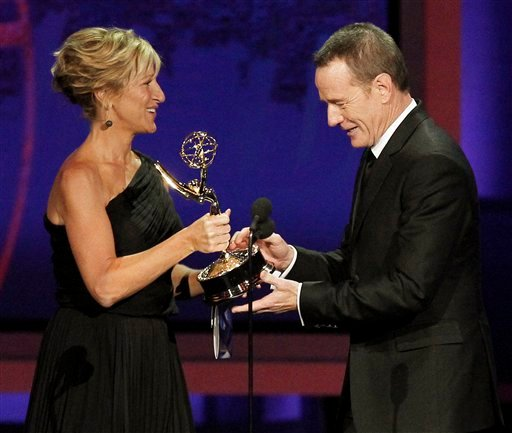 Edie Falco presents Bryan Cranston with the award for outstanding lead actor in a drama series for &quotBreaking Bad&quot during the 62nd Primetime Emmy Awards Sunday, Aug. 29, 2010, in Los Angeles. (AP Photo/Chris Carlson)