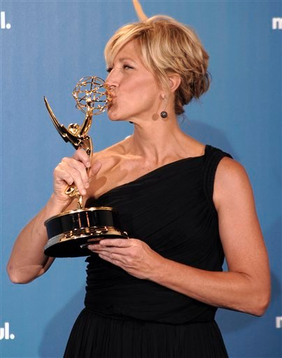 Actress Edie Falco poses in the press room with the award for outstanding lead actress in a comedy series for her work on &quotNurse Jackie&quot  during the 62nd Primetime Emmy Awards Sunday, Aug. 29, 2010, in Los Angeles. (AP Photo/Chris Pizzello)