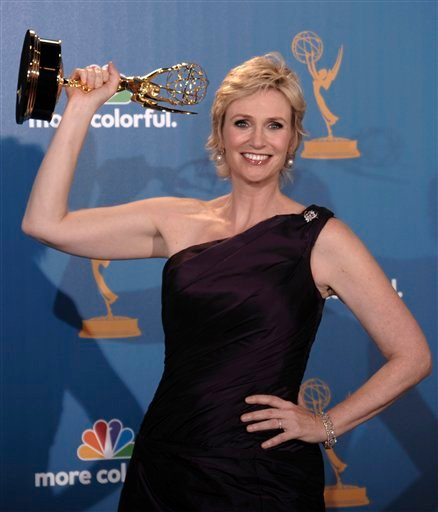 Actress Jane Lynch poses in the press room with the award for outstanding supporting actress in a comedy series for her work on &quotGlee&quot  during the 62nd Primetime Emmy Awards Sunday, Aug. 29, 2010, in Los Angeles. (AP Photo/Chris Pizzello)