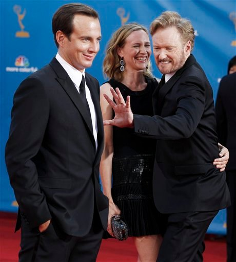 Will Arnett is photographed as Conan O'Brien and his wife Liza Powel joke around at the 62nd Primetime Emmy Awards Sunday, Aug. 29, 2010, in Los Angeles.(AP Photo/Matt Sayles)