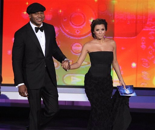 Presenters LL Cool J, left, and Eva Longoria Parker take the stage during the 62nd Primetime Emmy Awards Sunday, Aug. 29, 2010, in Los Angeles. (AP Photo/Chris Carlson)