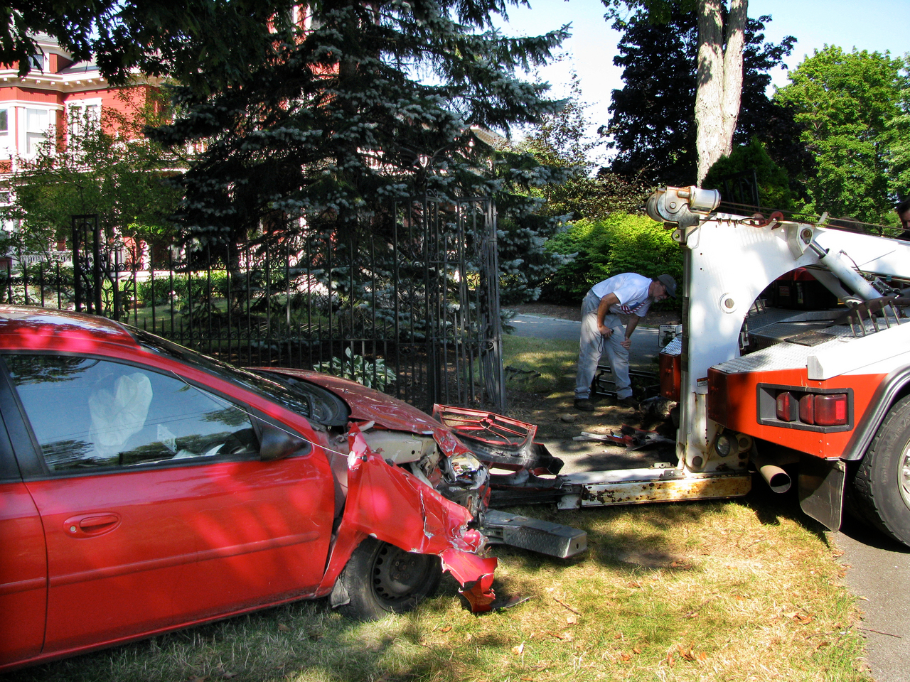 A wrecker prepares to remove a car after it crashed in to the front gate of Stephen and Tabitha King's West Broadway home in Bangor on Sunday, August 29, 2010. Renee Harris, 25, of Alton told police that she hit the gate with her 2011 Dodge Neon while avoiding another car that was driving on her side of the street. (Photo Courtesy of Jeff Kirlin via  Bangor Daily News)
