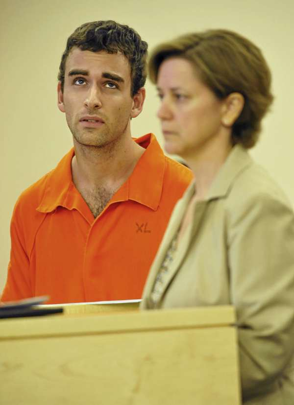 Standing next to his attorney Carolyn Adams,  Daniel Day, left, of Bangor  reacts to Judge Robert Murray setting his bail at $750 during Day's appearance at Penobscot Judical Center Monday afternoon, August 30, 2010. Day was arrested Saturday afternoon, August 28, 2010 after he allegedly fired shots in a backyard of a home on Mann Hill Road in Holden, Maine.(Bangor Daily News/ John Clarke Russ)