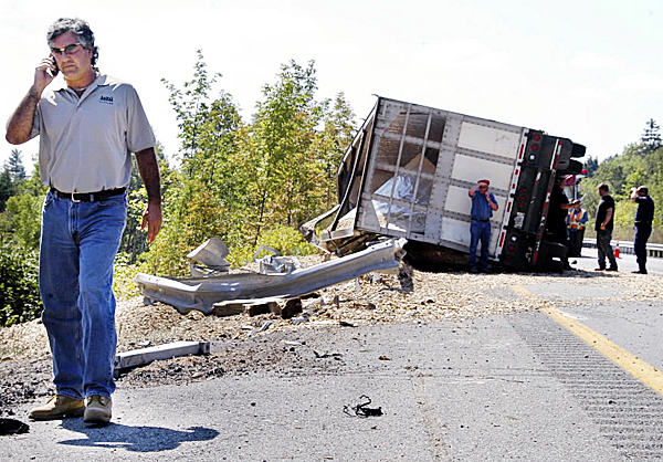 Gardner & Sons, Inc., co-owner Tom Gardner passes the wreckage of one of his company?s trucks on Interstate 95 in Township 2, Range 9 on Monday. The truck?s driver was killed. BANGOR DAILY NEWS PHOTO BY NICK SAMBIDES JR.