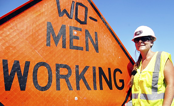 People, especially women, honk their horns and say, &quotYou go girl!&quot whenever they see the sign that construction worker Dawn Grover first altered on Thursday. The sign was still there on Monday. (Bangor Daily News/ Nick Sambides Jr.)