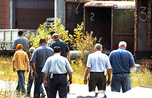 Bidders leave a warehouse at Moosehead Furniture in Monson on Tuesday, August 31, 2010 after a $1.1 million dollar bid by business woman Louise Jonaitis cancelled all other bidding. Some bidders came from as far away as Michigan. (Bangor Daily News/Kevin Bennett)