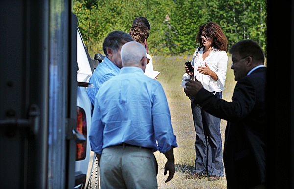 Louise Jonaitis, second from right, irons out details with Keenan Auction officials outside a warehouse during the second auction to sell off equipment of the former Moosehead Furniture factory. Joniatis's bid of $1.1 million forced the bidding inside to a halt and send bidders home empty handed for a second time. (Bangor Daily News/Kevin Bennett)