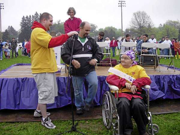Grandson Adam Mahaney, with Mike Hart of the ACS, takes photo of Gram at 2006 Relay for Life. Photo courtesy of the Mahaney family. FOR JONI COLUMN WEDNESDAY, SEPT. 1.