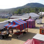 Crews set up a gaming tent Tuesday on the midway at the Blue Hill Fair grounds. The fair starts on Thursday and runs through Labor Day on Monday. Bangor Daily News Photo by Rich Hewitt