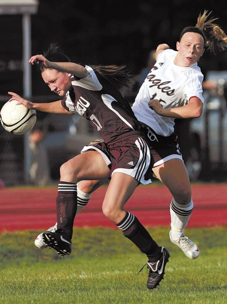 Caribou's Kendra Stephens, left, and Ellsworth's Gabbi Simbari collide as Simbari attempts a goal shot on Thursday, September 23, 2010 at Ellsworth.