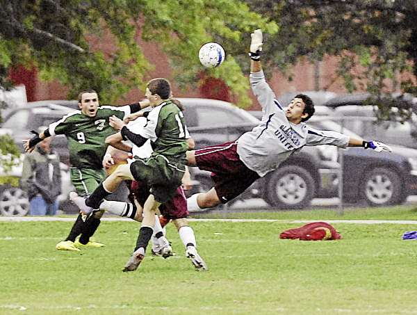 Orono keeper Alex Caballero jumps to deflect an Old Town shot in the second half of their game in Orono Monday, Sept. 27, 2010.