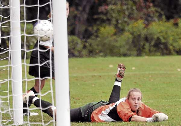 Old Town's goalkeeper Annie Cashon could only watch Orono's Hanna Renedo's shot go into the net during the firsh half of the game in Orono Tuesday afternoon. (Bangor Daily News/Gabor Degre)