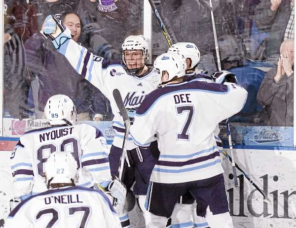Maine's Tanner House (center) celebrates his goal with teammates Robbie Dee, Gustav Nyquist and Will O'Neill during their Hockey East quarterfinal game last March in Orono. Maine has been picked to finish second in Hockey East in a preseason coaches poll announced by the league Wednesday.