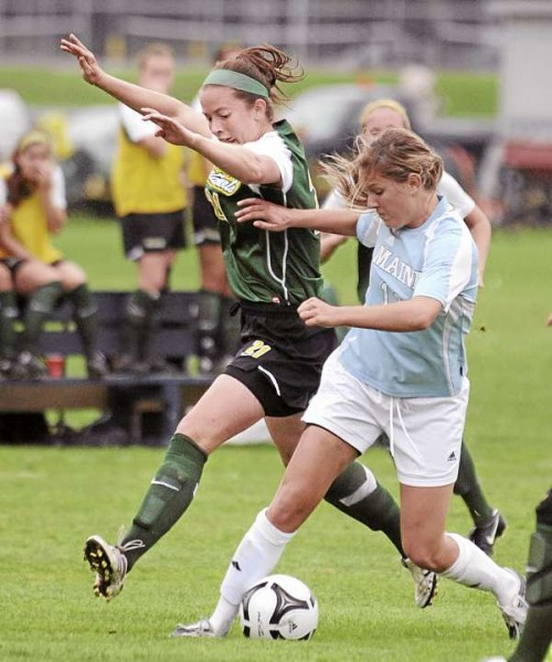 The University of Maine's Carolyne Nellis (right) and the Vermont's Heidi Hassler battle for the ball during the first half of their game in Orono Thursday afternoon.  The Black Bears won the game 2-1. (Bangor Daily News/Gabor Degre)