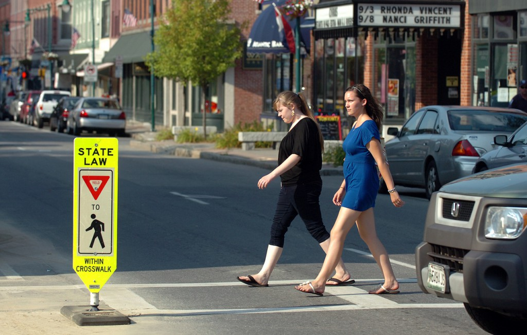Annie Gagne, 15, (left) and Eve Hupper, 17, both of Rockland, cross Main Street in Rockland on Tuesday, Aug. 31, 2010 on their way to Rock City Coffee. &quotYou definitely have to wait, even with the sign right there&quot said Gagne of being a pedestrian in Rockland, which plans to install new crosswalks this fall. (Bangor Daily News/Bridget Brown)