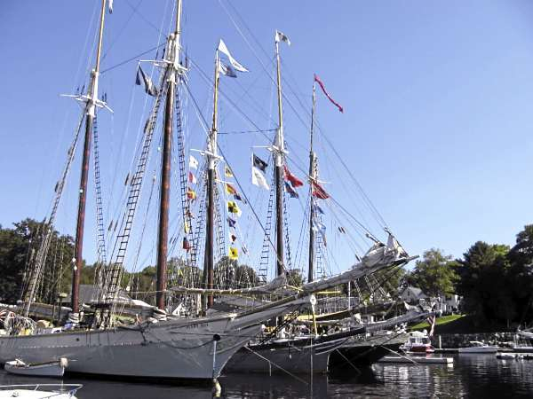 CAMDEN -- Pennants fly high and masts bristle at this weekend's Camden Windjammer Festival. Twenty four historic boats participated in Friday afternoon's parade of sail, including the Camden schooners Mary Day and Lewis R. French. (Bangor Daily News/Abigail Curtis)