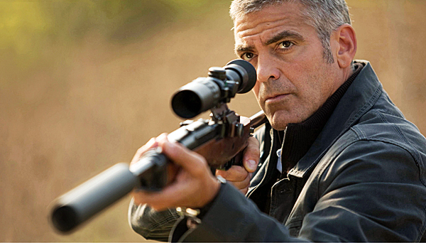 In this film publicity image released by Focus Features, George Clooney is shown in a scene from, &quotThe American.&quot (AP Photo/Focus Features, Giles Keyte)