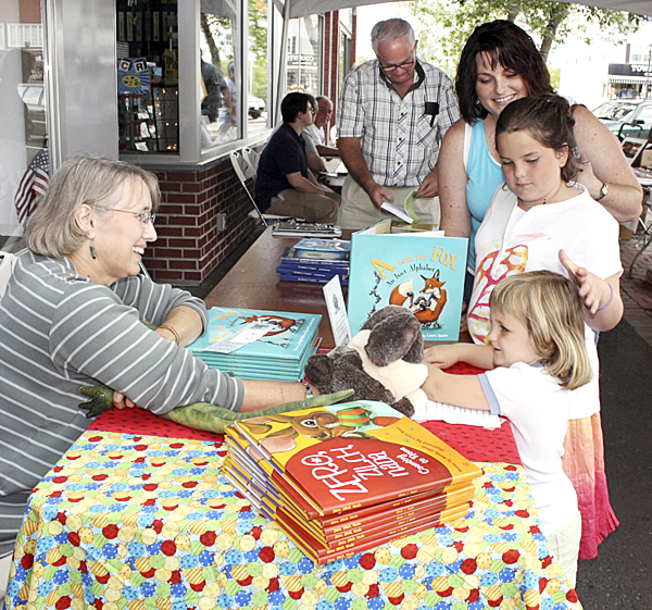 HI THERE ? Author Wendy Ulmer and her puppet Harry, interact with Addison Gravel, 3, during the recent event when 11 authors signed books in Market Square. Behind Addison is her sister Whitney, 7, and her mother Lisa Gravel. Houlton Pioneer Times Photo/Elna Seabrooks