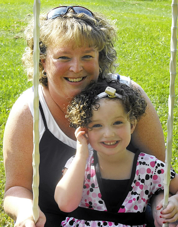 Bobbi Guerrette, 4, poses with her mom, Jamie Guerrette, while swinging on Wednesday, Sept. 1. Bobbi Guerrette was born with bilateral microtia with atresia. The condition is evident at birth and essentially means she was born without ears. Surgeons at The California Ear Institute in Palo Alto, Calif. created Bobbi's left ear, ear canal and an eardrum during a procedure on April 26. The 4-year-old will have surgery to create her right ear on Sept. 13. BANGOR DAILY NEWS PHOTO BY JEN LYNDS