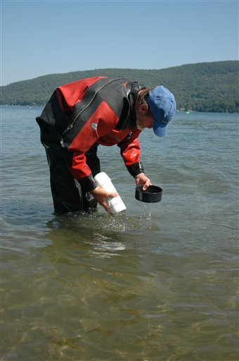In this Aug. 30, 2010 photo, Dan Marelli, of Tallahassee, Fla., a biologist and scuba diver specializing in mollusks, takes sediment samples in Lake George to study invasive Asian clams, in Bolton Landing, N.Y. Scientists consider the clams arrival a stroke of bad luck that could cause ecological and economic harm. They hope to smother the rapidly reproducing mollusks before they spread. (AP Photo/Mary Esch)