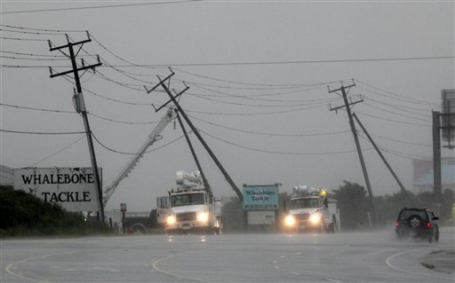 Utilities workers try to support power lines that were blown sideways from winds produced by Hurricane Earl in Nags Head, N.C., Friday, Sept. 3, 2010. (AP Photo/Gerry Broome)