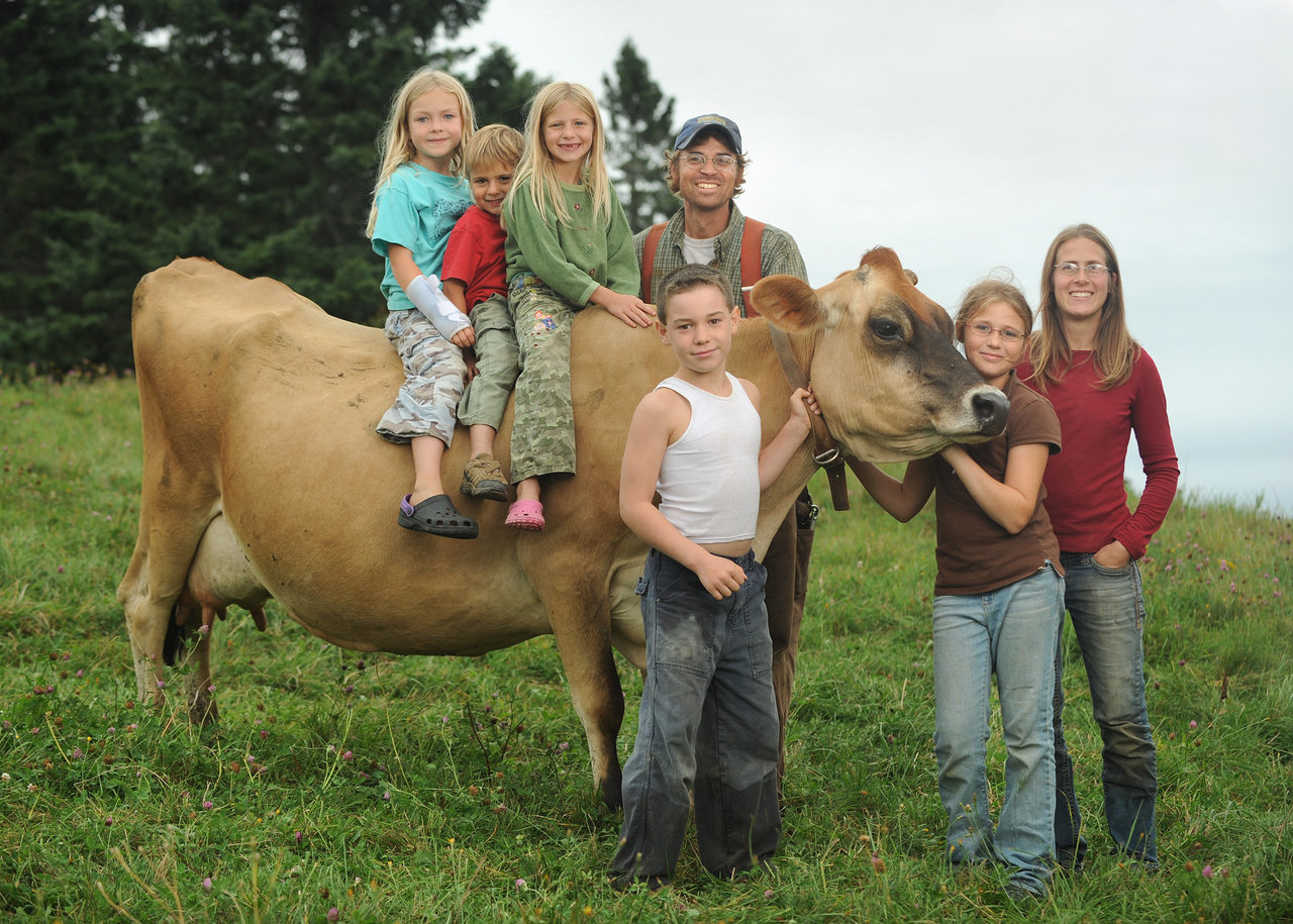 Dairy farmer Aaron Bell and wife Carly DelSignore, owners of Tide Mill Organic Farm, pose with their children and nieces and nephews--all members of the ninth generation of the family to live and work at the farm.  Children are, l-r:  Inez Furth, Henry Bell, Paige Bell, Finn Furth and Hailey Bell.   The Downeast farm operates an organic dairy and are members of MooMilk (Maine's Own Organic Mik Co.).  Photo taken August 25, 2010.  Photo by Brian Fitzgerald
