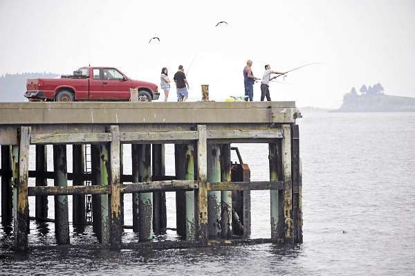 Many residents and tourists took advantage of Friday afternoon's pleasant weather and were seen fishing at the Eastport breakwater and window shopping in the downtown area  as Hurricane Earl was downgraded to a category one hurricane. (Bangor Daily News/ John Clarke Russ)