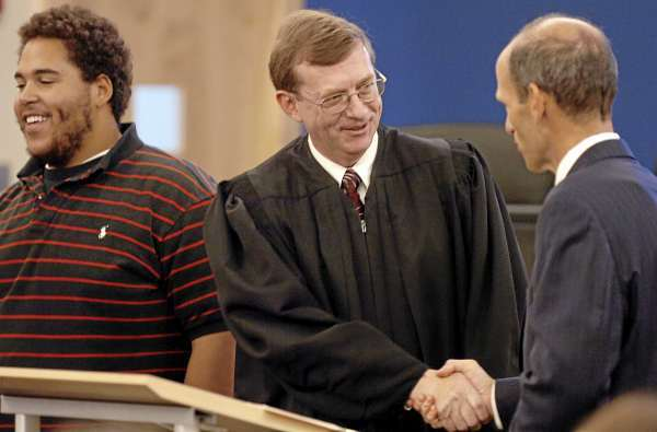 Robert Murray of Bangor shakes hands with Governor John Baldacci after he was sworn in as a Superior Court Justice at the Penobscot Judicial Center in Bangor on Friday, Sept. 3, 2010. Baldacci also administered the judicial oath to four other judges confirmed last month by the state Senate. Murray's son Dillon, 18, (left) helped robe him. (Bangor Daily News/Bridget Brown)