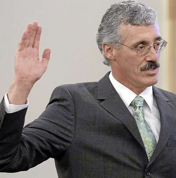 Bruce Jordan is pictured as Governor John Baldacci swears him in as a Superior Court Justice at the Penobscot Judicial Center in Bangor on Friday, Sept. 3, 2010. (Bangor Daily News/Bridget Brown)