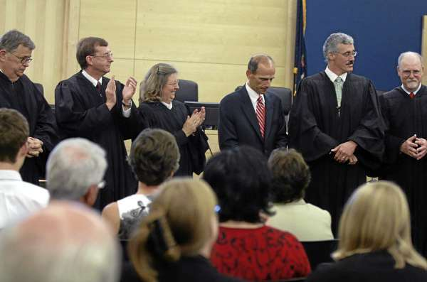 Newly sworn-in Superior Court Justices listen as Maine Supreme Court Chief Justice Leigh Saufley (not pictured) speaks to them after Governor John Baldacci swore them in at the Penobscot Judicial Center in Bangor on Friday, Sept. 3, 2010. Pictured (from left) are Justices Bernard O'Mara, Robert Murray, Ann Murray, Governor John Baldacci, Bruce Jordan and Charles Laverdiere. (Bangor Daily News/Bridget Brown)
