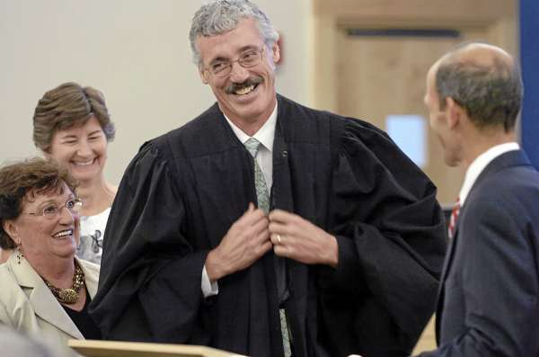 Bruce Jordan of Veazie smiles as he is robed with help from his mother Carole Jordan (left) and wife Kerry Jordan (second from left) after Governor John Baldacci swore him in as a Superior Court Justice at the Penobscot Judicial Center in Bangor on Friday, Sept. 3, 2010. Baldacci also administered the judicial oath to four other judges confirmed last month by the state Senate. (Bangor Daily News/Bridget Brown)