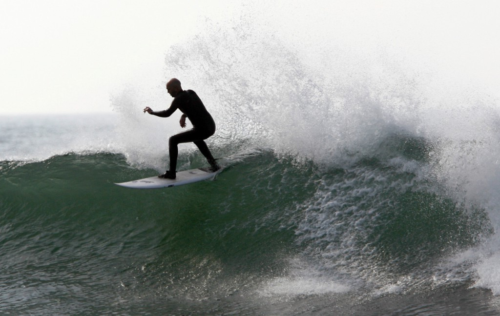 A surfer takes advantage of the waves churned up by Tropical Storm Earl, Saturday, Sept. 4, 2010, off of Gooch's Beach in Kennebunk, Maine. (AP Photo/Joel Page)