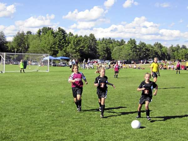 Jordan Foley (left) of the Saco Soccer Club, Ellie Horr of Brewer (middle) and Kelsi Day of Brewer (right) chase down the ball during a U11 girls soccer game at the Just for Fun youth tournament at Twin Brook Recreation Center in Cumberland Saturday afternoon.