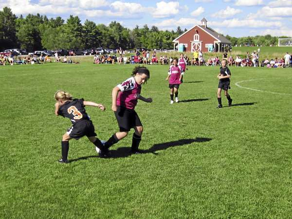 Ellie Horr (left) of Brewer and Saco's Elizabeth Roy vie for for the ball during a U11 girls soccer match at the Just for Fun tourmanent in Cumberland Saturday.