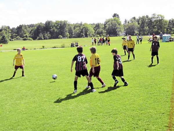 Bangor's Derek Courtney (87), Tate Perkins of Cape Elizabeth (middle) and Sean Adams of Bangor (far right) chase down a loose ball during a U11 boys game at the Just for Fun soccer tournament in Cumberland on Saturday. The game ended in a 0-0 tie.