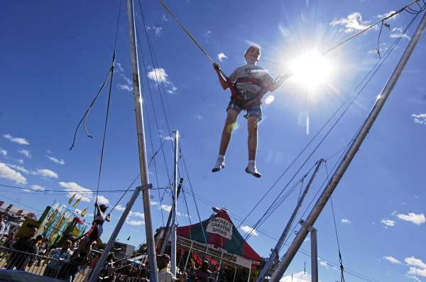 Harrison Vinall (cq),13,  of Ellsworth sprang into action with other kids on the Bungee Jump at the Blue Hill Fair Sunday, September 5, 2010. The annual fair kicked off Thursday and runs through Labor Day. (Bangor Daily News/John Clarke Russ)