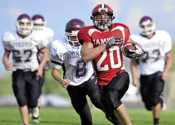 Camden Hills running back Jacob Powers (#20) runs in a touchdown as  Dominic Erickson and his Nokomis teammates pursue in the first quarter of their game Saturday, September 5, 2010. Camden defeated Nokomis 60-28 at Don Palmer Field in Rockport. (Bangor Daily News/John Clarke Russ)