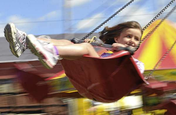 On the  &quotAir Time&quot ride,  Lidia Newenham (cq), 6, of Blue Hill smiles at her mother Katie Snow who was watching from the ground at the Blue Hill Fair Sunday, September 5, 2010. The annual fair kicked off Thursday and runs through Labor Day. (Bangor Daily News/John Clarke Russ)
