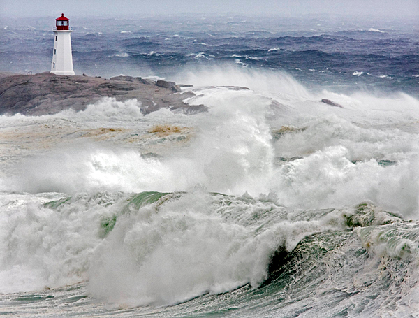 Waves from hurricane Earl pound the coast at Peggys Cove, Nova Scotia, Saturday, Sept. 4, 2010. Police closed roads leading to the iconic lighthouse as a safety precaution, keeping the curious away from the dangerous rocks. Heavy rain, high winds and surf battered the region.  (AP Photo/The Canadian Press, Andrew Vaughan)