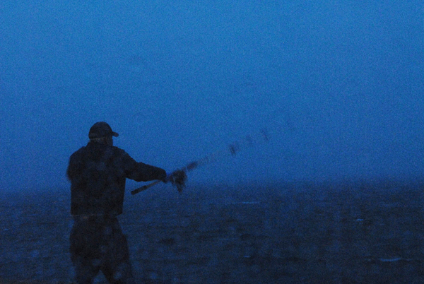 Tropical Storm Earl didn't stop Dennis Barry of Kenduskeag from fishing for mackerel around 5:30 a.m. Saturday at Eastport's breakwater in heavy rain and winds up to 26 mph. (Bangor Daily News/John Clarke Russ)